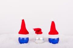 Julbollar med röda lock Royaltyfria Bilder