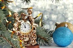 Julbollar och klocka Royaltyfria Foton