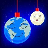 Julbollar som formas som jordklotet och månen Arkivbilder