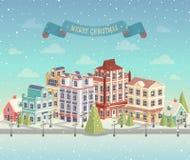 Julcityscape och snöfall Arkivfoton
