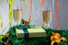 Julcollage med gåvor, champagne, leksaker och granträdfilialer nytt år för bakgrund royaltyfri foto