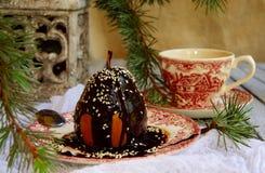 Julefterrättpäron med choklad arkivfoto