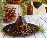 Julefterrättpäron med choklad fotografering för bildbyråer