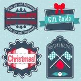 Julemblem, etiketter, klistermärkear i retro stilvektor Arkivfoton