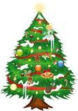 julen dekorerade treen Arkivbilder