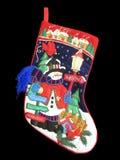 julen färgade I-strumpan arkivfoto