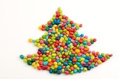 julen färgade många treen Arkivfoto