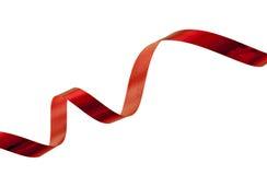 julen isolerade det röda blanka spiral bandet royaltyfri fotografi
