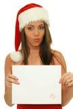 Julen kvinna somvisningen kopierar utrymme, undertecknar Royaltyfri Foto