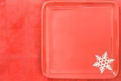 julen plate den röda tableclothen Royaltyfria Bilder