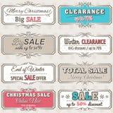 Juletiketter med försäljningserbjudande Arkivfoto