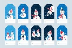 Juletiketter med hand drog gulliga snögubbear Arkivfoto