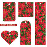 Juletiketter med röd julstjärnabakgrund Royaltyfri Fotografi