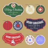 Juletikettuppsättning med önska för nytt år på dekorativ bakgrund royaltyfri illustrationer