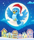 Julfågel ovanför stad Arkivfoto