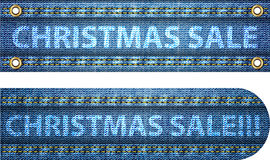 Julförsäljningsord på jeansbakgrund Arkivbild