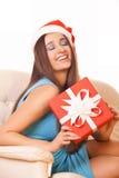 Julflicka i den Santa Claus hatten Fotografering för Bildbyråer