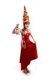 Julflicka i en röd klänning för karneval Arkivfoton