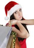 Julflicka med att truta för shoppingpåsar Fotografering för Bildbyråer
