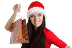 Julflicka med den närvarande påsen Fotografering för Bildbyråer