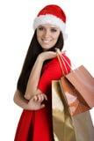Julflicka med shoppingpåsar Royaltyfri Bild