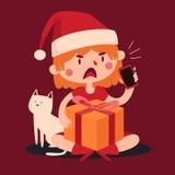 Julflicka som argumenterar på telefonen och innehavet per närvarande nästa t Arkivbilder