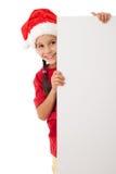 Julflicka som plattforer med det tomma mellanrumet Royaltyfri Fotografi