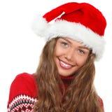 Julflicka, ung härlig le ung kvinna i H för santa ` s Fotografering för Bildbyråer