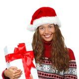 Julflicka, ung härlig le ung kvinna i H för santa ` s Arkivbild