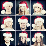 Julfolk Man, kvinna och barn i Santa Hat Arkivfoton