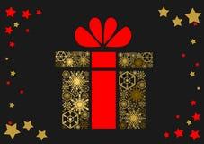 Julgåva med en röd pilbåge på en mörk bakgrund Royaltyfri Fotografi