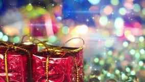 Julgåvaaskar och skimrande partiklar Arkivfoto