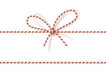 Julgåvaband: pilbåge-fnuren av röd och vit vriden kabel Vektorillustration, EPS10 royaltyfri illustrationer