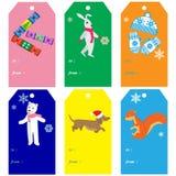 Julgåvaetiketter och inbjudankort med smällkarameller Arkivbild