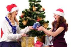 julgåvaflicka santa två royaltyfria bilder