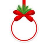 Julgåvakort med ett rött satängband och a  Royaltyfria Foton
