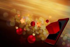 Julgåvor på mobil Arkivbilder