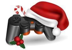 Julgamepad Gamepad med en Santa Claus hatt, godis och järnek royaltyfri illustrationer
