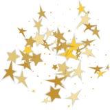 Julgarnering av guld- konfettistjärnor mot vitbaksida Arkivfoton