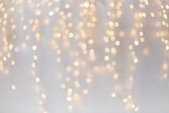 Julgarnering eller girlandljusbokeh Arkivbilder