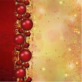 Julgarnering i röda och guldband Arkivfoto