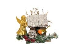 Julgarnering med de fågelhuset och angesna Arkivfoto