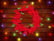 Julgarnering med julstjärnan på wood bakgrund Royaltyfria Foton