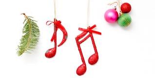 Julgarnering med musikaliska anmärkningar på vit bakgrund Royaltyfri Fotografi