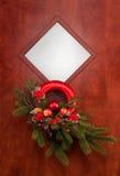 Julgarnering på dörren Royaltyfri Foto