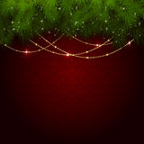 Julgarnering på den röda tapeten Arkivbild