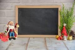 Julgarnering på träbackgroun Arkivbild
