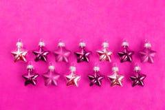 Julgarnering, stjärnor, rosa färger Fotografering för Bildbyråer
