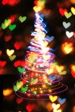 Julgran från färgljus Arkivbild