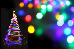 Julgran från färgljus Royaltyfri Bild